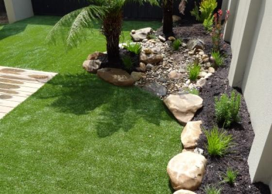 Turf / Lawns and stone edging border idea Melbourne Landscaping